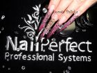 Nails done using Nail Perfect Professional System products.<br />Nail Perfect manicure towel.